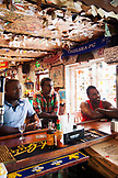 BERUMDA. Chef Marcus Samuelsson having a drink with the locals while watching a soccer game at the Swizzle Inn at Bailey's Bay.