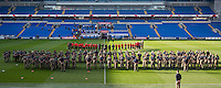 Wales players and staff line up in front of Military Training Preparation College students to observe the November 11th armistice silence ahead of a Wales Training Session at Cardiff City Stadium, Cardiff, Wales on 11 November 2016. Photo by Mark  Hawkins.