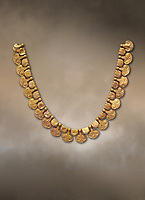 Mycenaean gold necklace with waz lily shaped beads from the Mycenaean cemetery of Midea tomb 10, Dendra, Greece. National Archaeological Museum Athens Cat no 8748.
