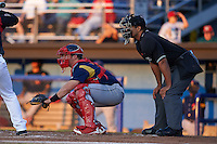 State College Spikes catcher Jesse Jenner (15) and umpire Jose Matamoros during a game against the Batavia Muckdogs August 22, 2015 at Dwyer Stadium in Batavia, New York.  State College defeated Batavia 5-3.  (Mike Janes/Four Seam Images)