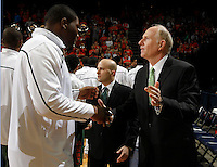 CHARLOTTESVILLE, VA- JANUARY 7: Reggie Johnson #42 of the Miami Hurricanes shakes hands with head coach Jim Larranaga of the Miami Hurricanes during the game against the Virginia Cavaliers on January 7, 2012 at the John Paul Jones Arena in Charlottesville, Virginia. Virginia defeated Miami 52-51. (Photo by Andrew Shurtleff/Getty Images) *** Local Caption *** Jim Larranaga;Reggie Johnson