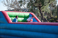 "Students enjoy Spring Fest 2015 Pre-show activities on Stewie Beach and the Braun parking lot. The event included food trucks, a bounce house, a beer garden, live entertainment from the band ""Dinner"", and more. (Photo by Nick Harrington, Occidental College Class of 2017)"
