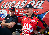 Sep 16, 2018; Mohnton, PA, USA; NHRA top fuel driver Doug Kalitta (right) and teammate Richie Crampton during the Dodge Nationals at Maple Grove Raceway. Mandatory Credit: Mark J. Rebilas-USA TODAY Sports