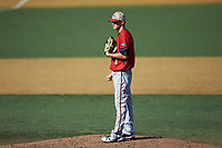 Gardner-Webb Runnin' Bulldogs starting pitcher looks to his catcher for the sign against the Wake Forest Demon Deacons at David F. Couch Ballpark on February 18, 2018 in  Winston-Salem, North Carolina. The Demon Deacons defeated the Runnin' Bulldogs 8-4 in game one of a double-header.  (Brian Westerholt/Four Seam Images)