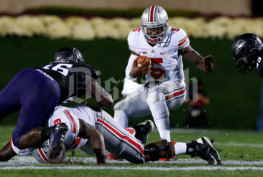 Ohio State Buckeyes quarterback Braxton Miller (5) carries the ball in the first quarter of their game at Ryan Field in Evanston, IL on October 5, 2013. Columbus Dispatch photo by Brooke LaValley)
