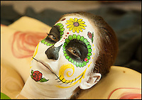 BNPS.co.uk (01202 558833)<br /> Pic: ReneRodriguez/BNPS<br /> <br /> ***Must use full byline***<br /> <br /> A model's painted face. <br /> <br /> This may look like an ornate Mexican sugar skull but a closer inspection reveals it is actually made up of cleverly painted people.<br /> <br /> The incredible artwork is comprised of seven nude women who have each been covered in sparkling white body paint and brightly coloured patterns.<br /> <br /> When the models all get into position they form a perfect sugar skull - the brightly coloured icon of the Day of the Dead festival, a Mexican tradition.<br /> <br /> The idea for the eye-catching piece was thought up by Rene Rodriguez, a photographer in Los Angeles, USA.