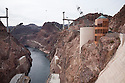 Hoover Dam spans the Colorado River at the border between Nevada and Arizona. Lake Mead is the reservoir behind the dam. The dam's hydroelectric power station generates, on average, about 4 billion kilowatt-hours of power a year and is distributed to Nevada, Arizona, and California. It meets the energy needs of approximately 1.3 million people. Lake Mead is also a significant source of municipal drinking water and agricultural water for the region. Almost a decade of drought and increased water demand have brought Lake Mead near its lowest level in over 40 years. Photo taken February 2009.