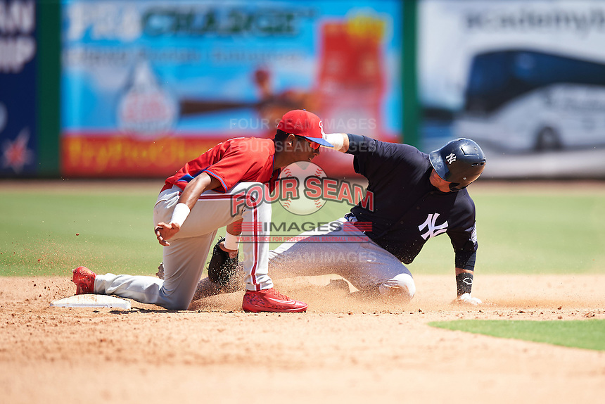 New York Yankees Luis Torrens (25) slides into second base as shortstop Jonathan Guzman (11) applies the tag during an Instructional League game against the Philadelphia Phillies on September 27, 2016 at Bright House Field in Clearwater, Florida.  (Mike Janes/Four Seam Images)