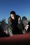 Runner J.T. Schauermann from Littleton High School poses with his track shoes on Friday, February 24, 2006 at the track during practice.  He is the National Junior Olympics Champion in the 400 meter race, and rated 4th in the country.   ELLEN JASKOL/ROCKY MOUNTAIN NEWS).***T.J. Schauermann (assignment)