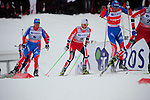 HOLMENKOLLEN, OSLO, NORWAY - March 16: (L-R) Ilia Chernousov of Russia (RUS) and Martin Johnsrud Sundby of Norway (NOR) during the Men 50 km mass start, free technique, at the FIS Cross Country World Cup on March 16, 2013 in Oslo, Norway. (Photo by Dirk Markgraf)