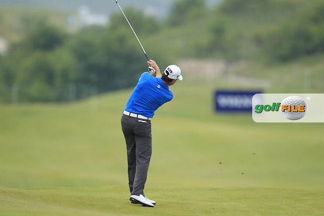 Brett Rumford (AUS) plays his 2nd shot on the 4th hole during Friday morning's group of the 2013 Volvo World Matchplay Championship held  at the Thracian Cliffs Golf & Beach Resort, Kavarna, Bulgaria, 17th May 2013..Picture: Eoin Clarke www.golffile.ie.