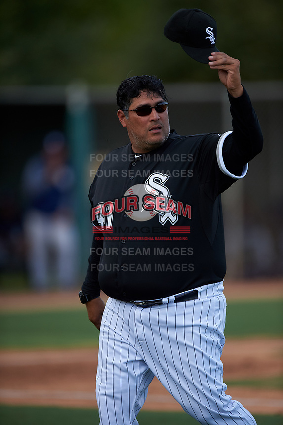 AZL White Sox pitching coach Felipe Lira (41) motions to the bullpen as he walks off the field during an Arizona League game against the AZL Padres 2 on June 29, 2019 at Camelback Ranch in Glendale, Arizona. The AZL Padres 2 defeated the AZL White Sox 7-3. (Zachary Lucy/Four Seam Images)