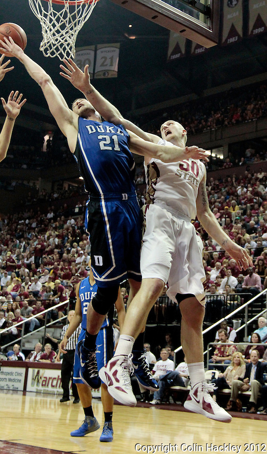TALLAHASSEE, FLA. 2/23/12-FSU-DUKE022312 CH-Duke's Miles Plumlee gets a hand in front of FSU's Jon Kreft for the rebound during first half action Feb. 23, 2012 in Tallahassee..COLIN HACKLEY PHOTO