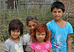 Children pose in a largely Roma, Turkish-speaking neighborhood of Dobrich, in the northeast of Bulgaria.