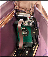 BNPS.co.uk (01202 558833)Pic: Astons/BNPS<br /> <br /> Handbag camera - with lens concealed behind buckle.<br /> <br /> Cold War Collectables - Auction of Soviet spy camera's from behind the Iron Curtain reveal the KGB's cunning and ingenuity at the height of the Cold War.<br /> <br /> A fascinating collection of Russian spy cameras which were used clandestinely at the height of the Cold War have emerged for sale for &pound;60,000.<br /> <br /> The ingenious gadgets deployed by KGB operatives include cameras built into the sides of briefcases, buttons of jackets, umbrella handles and cigarette cases.<br /> <br /> The sale also features a clever 'Zenit' F-21 spy camera which shoots photos through the side of a camera case when it appears to be shut.<br /> <br /> There are also several 'Minox' cameras which are known as the 'James Bond' spy camera as one appeared in the film On Her Majesty's Secret Service (1969).
