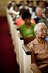 Alzona Blackshear, 84, listens to the church service at Providence Missionary Baptist Church in Atlanta, Georgia August 15, 2010. The Reverend Dr. Gerald L Durley preaches health to his congregation and has made a name for himself for giving back to the community.