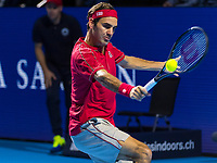 27th October 2019; St. Jakobshalle, Basel, Switzerland; ATP World Tour Tennis, Swiss Indoors Final; Roger Federer (SUI) hits a backhand in the match against Alex de Minaur (AUS) - Editorial Use