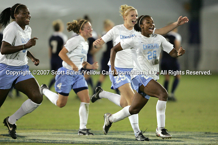 9 November 2007: North Carolina players (l to r) Jaime Gilbert, Meghan Klingenberg, Betsy Frederick, and Nikki Washington rush to congratulate goalkeeper Ashlyn Harris (not pictured) after she made the save in the penalty kick shootout to send UNC to the final. The University of North Carolina tied the University of Virginia 1-1 at the Disney Wide World of Sports complex in Orlando, FL in an Atlantic Coast Conference tournament semifinal match.  UNC advanced to the finals on penalty kicks, 4-2.