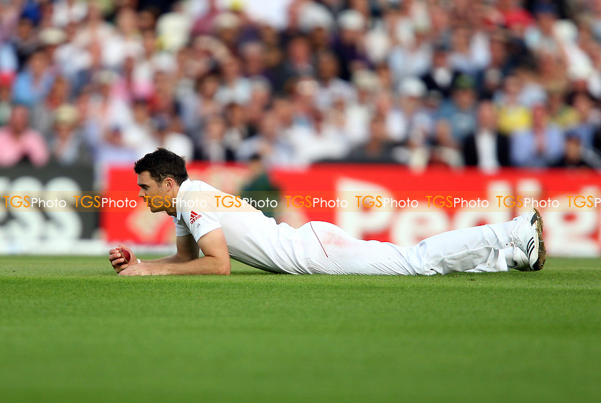 James Anderson of England completes the caught and bowled of Ryan Harris - England vs Australia - 2nd day of the 5th Investec Ashes Test match at The Kia Oval, London - 22/08/13 - MANDATORY CREDIT: Rob Newell/TGSPHOTO - Self billing applies where appropriate - 0845 094 6026 - contact@tgsphoto.co.uk - NO UNPAID USE