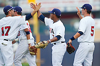 Deven Marrero #17 (Arizona State), Marcus Stroman #3 (Duke) and Matt Reynolds #5 (Arkansas) of the USA Baseball Collegiate National Team celebrate their victory over the Japan Collegiate National Team at the Durham Bulls Athletic Park on July 3, 2011 in Durham, North Carolina.  USA defeated Japan 7-6.  (Brian Westerholt / Four Seam Images)