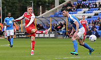 Fleetwood Town's Ashley Hunter gets a shot away past Peterborough United's Andrew Hughes<br /> <br /> Photographer David Shipman/CameraSport<br /> <br /> The EFL Sky Bet League One - Peterborough United v Fleetwood Town - Friday 14th April 2016 - ABAX Stadium  - Peterborough<br /> <br /> World Copyright &copy; 2017 CameraSport. All rights reserved. 43 Linden Ave. Countesthorpe. Leicester. England. LE8 5PG - Tel: +44 (0) 116 277 4147 - admin@camerasport.com - www.camerasport.com