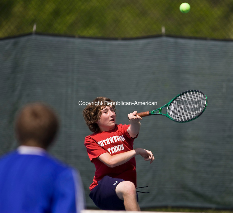 LAKEVILLE, CT - 21 MAY 2010 -052110JT16-<br /> Northwestern's Tyler LeMieux returns the ball to Housatonic's A. J. Opgenorth and Conor McCarthy during a doubles match with LeMieux's teammate Alex Hill during Friday's Berkshire League Tennis Championship at the Hotchkiss School in Lakeville.<br /> Josalee Thrift Republican-American