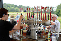 People enjoy Wisconsin Brewing Company's beer during the Depth Charge brew party on Sunday, July 12, 2015, in Verona, Wisconsin.