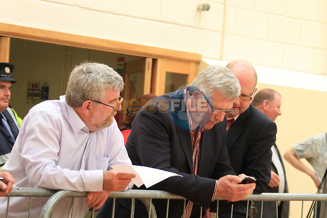 Minister of State Fergus O'Dowd T.D. and Ged Nash TD (R) at the Fiscal Treaty referendum votes are counted and sorted at the count centre in Dundalk, Co Louth..Picture Fran Caffrey www.newsfile.ie