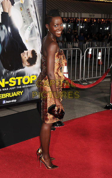 WESTWOOD, CA- FEBRUARY 24: Actress Lupita Nyong'o arrives at the 'Non-Stop' - Los Angeles Premiere at Regency Village Theatre on February 24, 2014 in Westwood, California.<br /> CAP/ROT/TM<br /> &copy;Tony Michaels/Roth Stock/Capital Pictures