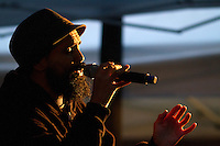 A hip hop artist Gabriel Teodros rallies the crowd in Occidental Park during the People's Climate March in Seattle, Wash. on October 14, 2015. (photo © Karen Ducey for the Sierra Club)
