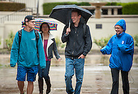 Students walk through the Academic Quad during a light rain, Feb. 28, 2014. (Photo by Marc Campos, Occidental College Photographer)