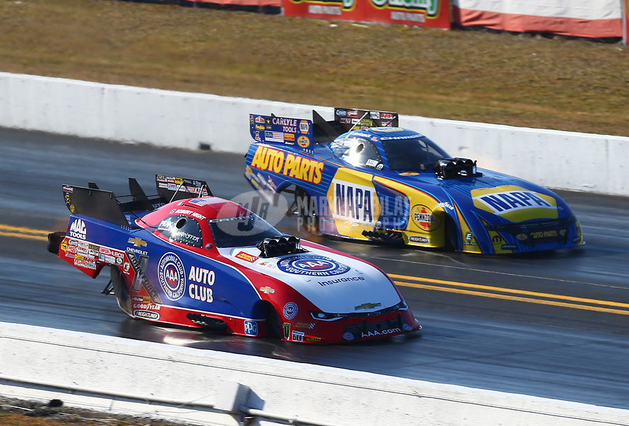 Mar 18, 2017; Gainesville , FL, USA; NHRA funny car driver Robert Hight (near) races alongside Ron Capps during qualifying for the Gatornationals at Gainesville Raceway. Mandatory Credit: Mark J. Rebilas-USA TODAY Sports