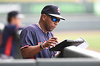 Coach Bobby Moore (1) of the Rome Braves looks over his notes in game one of a doubleheader against the Greenville Drive on Tuesday, May 30, 2017, at Fluor Field at the West End in Greenville, South Carolina. Rome won, 10-7. (Tom Priddy/Four Seam Images)