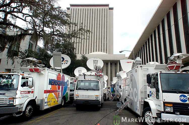State and national TV satellite trucks parked behind the capitol were ready to send the press conference live around the world during the contested 2000 presidential election legal issues in Tallahassee, Florida November 17, 2000.  WTSP's truck is one of 20 or more between the Capitol and the Supreme Court building.
