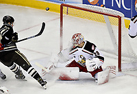 HERSHEY, PA - JANUARY 05: Grand Rapids Griffins goalie Harri Sateri (29) deflects the puck away as Hershey Bears left wing Liam O'Brien (20) stops in front of the net and sprays ice on him during the Grand Rapids Griffins vs. Hershey Bears AHL game at the Giant Center in Hershey, PA. (Photo by Randy Litzinger/Icon Sportswire)