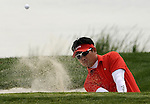 SUZHOU, CHINA - APRIL 17:  Y.E. Yang of Korea plays a bunker shot on the 1st hole during the Round Three of the Volvo China Open on April 17, 2010 in Suzhou, China. Photo by Victor Fraile / The Power of Sport Images