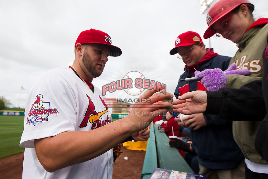 Matt Adams #53 of the St. Louis Cardinals signs autographs for fans prior to a game against the Tulsa Drillers at Hammons Field on May 4, 2013 in Springfield, Missouri. Adams was on a four game rehab assignment in Springfield. (David Welker/Four Seam Images)