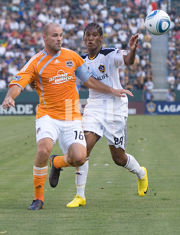Houston Dynamo defender Craig Waibel (16) battles LA Galaxy midfielder Alex Cazumba (88) for a loose ball. The LA Galaxy defeated the Houston Dynamo 4-1 at Home Depot Center stadium in Carson, California on Saturday evening June 5, 2010..