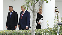 US President Donald J. Trump (2L), Polish President Andrzej Duda (L), Polish First Lady Agata Kornhauser-Duda (2R) and First Lady Melania Trump (obscured) walk along the Colonnade at the White House in Washington, DC, USA, 12 June 2019. During the visit President Trump and President Duda will participate in a signing ceremony to increase military to military cooperation including the purchase of F-35 fighter jets and an increased US troop presence in Poland. <br /> Credit: Shawn Thew / Pool via CNP/AdMedia