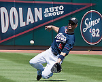 Reno Aces Cole Gillespie attempts to make the sliding chatch agianst the Fresno Grizzlies on Sunday afternoon, August 26, 2012 in Reno, Nevada.