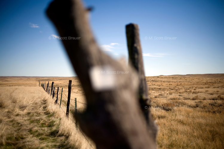 A view of a fence on the Coffee Ranch in rural Rosebud County near Melstone, Montana, USA.