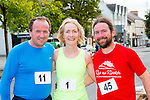 Fred Browne, Majella Diskin and Dave McBride who competed  in the Castleisland 5km  road race on Friday evening