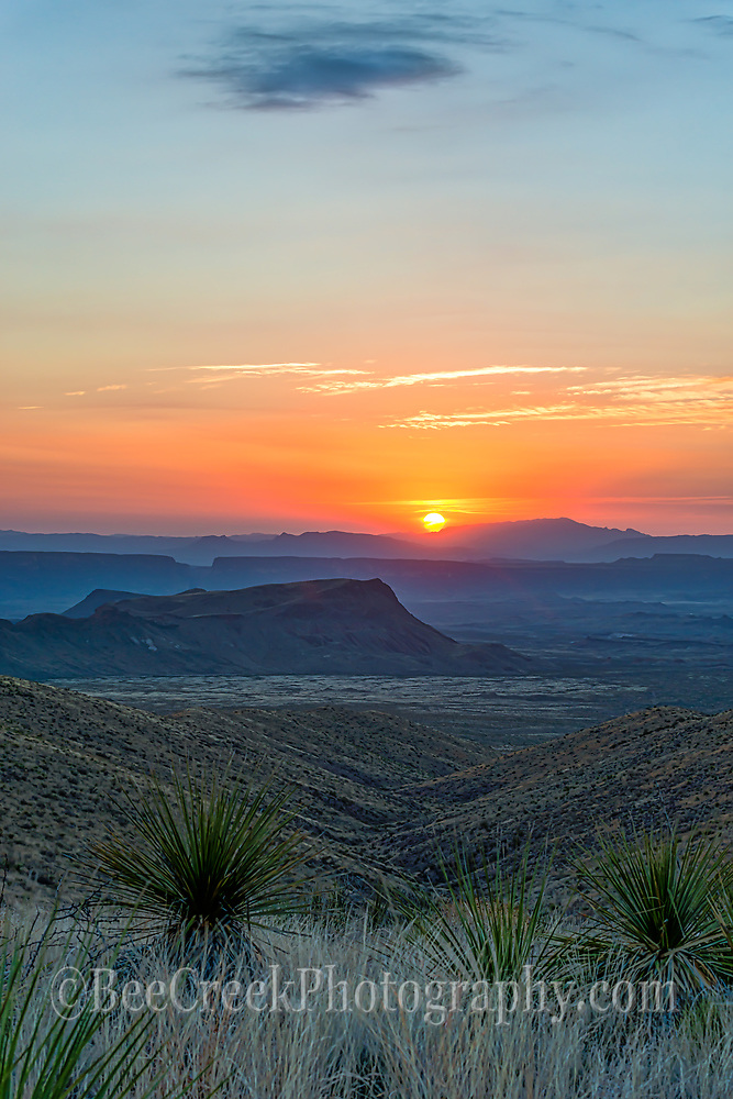 Another view of the sunset in a vertical format at the Sotal Overlook in Big Bend National Park. With these wonderful colorful sunset going down over the Sierra Ponce mountain range in Mexico, which is behind Santa Elena Canyons.
