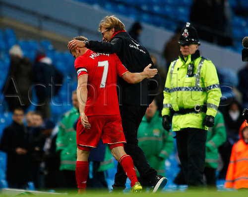 21.11.2015. The Etihad, Manchester, England. Barclays Premier League. Manchester City versus Liverpool. Liverpool skipper James Milner and Liverpool manager Jurgen Klopp leave the pitch at the final whistle, with three points in the bag.