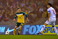 MELBOURNE, AUSTRALIA - JUNE 7: Brett Holman of the Socceroos evades a tackle by Dejan Stankovic of Serbia during an international friendly match between the Qantas Australian Socceroos and Serbia at Etihad Stadium on June 7, 2011 in Melbourne, Australia. Photo by Sydney Low / AsteriskImages.com