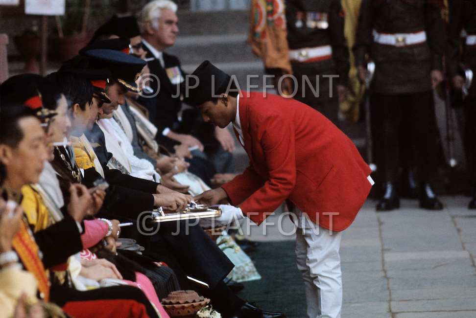 February 24th, 1975. Kathmandu. Nepal. The Coronation of King Birendra and Queen Aishwarya of Nepal, on the chosen day. At 8:37 a.m., the precise moment selected by court astrologers more than a year before, the royal priest placed the huge jewel-encrusted crown on the King's head and a diamond tiara atop Queen Aishwarya's. They were both massacred by their son Dipendra  on 1 June 2001. Photo of V.I.P. guests for the coronation.