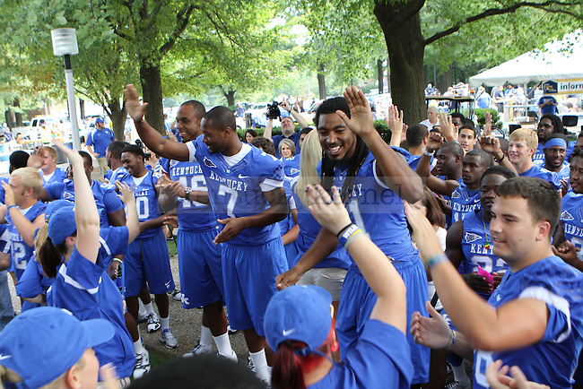 The University of Kentucky football team and band played music and sang the fight song while students moved into South Campus on Friday, August 19, 2011 in Lexington, Kentucky. Photo by Latara Appleby | Staff