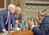 """United States Senator John McCain (Republican of Arizona), Chairman, US Senate Committee on Armed Services, left, US Senator Jack Reed (Democrat of Rhode Island), ranking member, center, discuss testimony with US Secretary of Energy Ernest Moniz, right, following the committee hearing on """"Impacts of the Joint Comprehensive Plan of Action (JCPOA) on U.S. Interests and the Military Balance in the Middle East"""" with on Capitol Hill on Wednesday, July 29, 2015.<br /> Credit: Ron Sachs / CNP"""