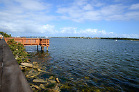 Bright, sunny, late morning view of a fishing dock located directly on the intracoastal waterway in Boynton Beach, Florida.