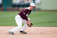 Travis McComack #31 of the Missouri State Bears bobbles a hit ball to short during a game against the Wichita State Shockers at Hammons Field on May 5, 2013 in Springfield, Missouri. (David Welker/Four Seam Images)